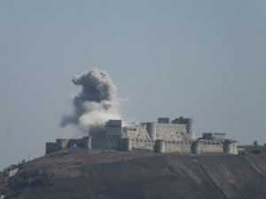 Krak des Chevaliers being bombed by Syrian air force jets, March 2014