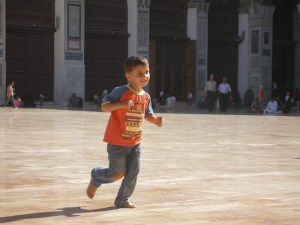 Carefree child playing the courtyard of the Umayyad Mosque, June 2010 [DD]
