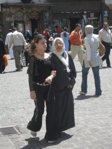 Young and old arm in arm in Damascus