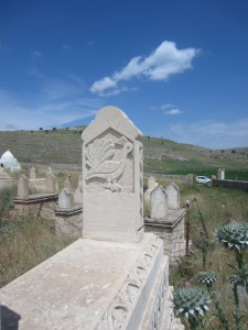 Yazidi tombstone in southeast Turkey showing the peacock symbol, representing God on earth [DD, May 2014]