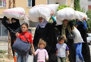 Arab families returning to Tel Abyad