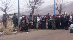 Madaya fake residents guarded by assad soldiers