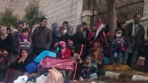 Madaya well-fed imposters with Syrian flag showing they are in Assad area
