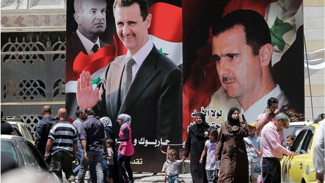 Assad posters