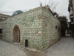 Al-Akhal Mosque, dating to 1485, now bears garish, green-painted mortar
