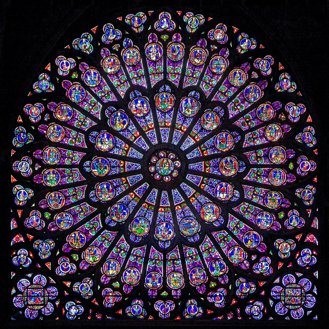 1280px-Gothic-Rayonnant_Rose-6 North rose window Notre Dame c1250